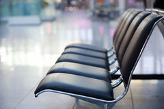 Airport seats. Black airport seats in a row Stock Image