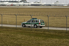Airport Security. A police car behind a security fence at the Munich airport Royalty Free Stock Photos