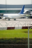 Airport security. Razor wire soft focus view royalty free stock image