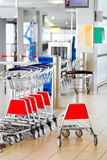 Airport security check point. Luggage scanner and carts Royalty Free Stock Images