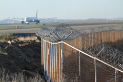 Airport security fence around runway Royalty Free Stock Image