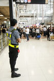 Airport Security Guard standing for security and protection peop Stock Image