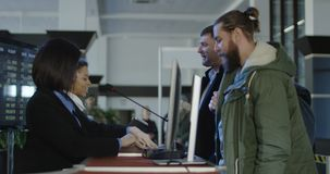 Airport security personnel checking identification stock footage
