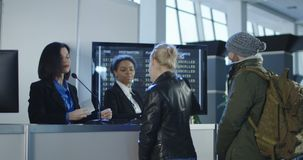 Airport security personnel processing passengers stock footage