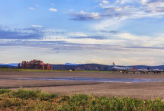 Airport  in Sedona, USA. Sedona Airport.Red rocks visible on the horizon. Few private jets parked near runway. Sunset time colored picture in warm colors Royalty Free Stock Photography