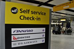 Airport self service check in sign Stock Photo
