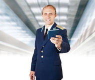 Airport service man with  documents on the flight in hand Stock Image
