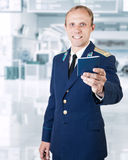 Airport service man with  documents on the flight in hand Royalty Free Stock Images