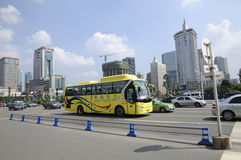 Airport shuttle bus running through Tianfu Square. A shuttle bus from Shuangliu International Airport is crossing through Tianfu Square,center of the city,at royalty free stock photos