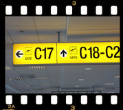 Airport sign. Yellow airport sign inside film strip Royalty Free Stock Photo