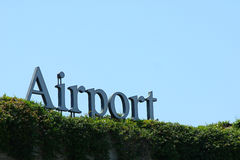 Airport Sign. An airport sign with a hedge in the foreground Stock Photo