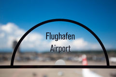 Airport sign on transparent window Royalty Free Stock Image