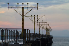 Airport signal lights on the sea Royalty Free Stock Image