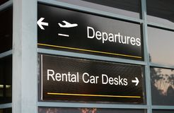 Airport Signs. Departures and rental cars Stock Photo