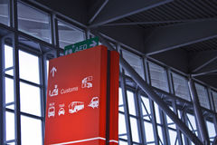 Airport signs. For AED, customs control, ticket cassa, currency exchange, charter busses, taxi, train stock photography