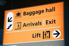 Airport signs in Amsterdam. Generic airport signage in Amsterdam. Illuminated sign. Baggage hall, arrivals and exit royalty free stock photography