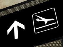 Airport signs - Arrivals area. Airport sign pointing to arrival area, placed on exposed concrete beam royalty free stock photography