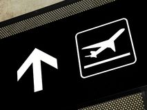 Airport signs - Departures area. Airport sign pointing to departure area, placed on exposed concrete beam royalty free stock image