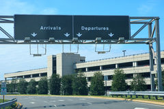 Airport Signs Dulles International Virginia. These arrival and departure signs indicate travel lanes for drivers at Dulles International Airport in Virginia royalty free stock photos
