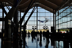 Airport silhouette with plane Stock Photo