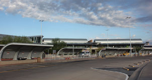 Airport, sky, parking lot. A landscape view of an airport and the partially cloudy sky along with the parking lot. Taken in Arizona 2015 Stock Image