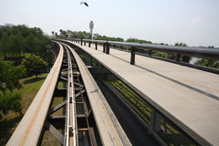 Airport Skytrain with Bird. Airport skytrain in Florida, with bird and bird shadow on track Royalty Free Stock Photo