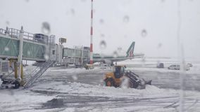 Airport. Snow Cleanup airport in Bucharest in December 2014 filmed by airplane window