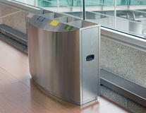 Airport stainless rubbish bin. Metal trash recycle bin at international airport, with glass, plastic, paper and mxied waste Royalty Free Stock Photos