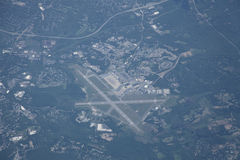 Airport and suburban landscape from high altitude Royalty Free Stock Image