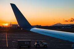 Airport Sunrise. Looking out of an airplane window of a sunrise with Mount Fuji in the distance Stock Images
