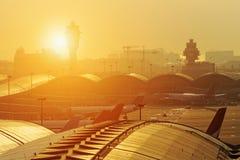 Airport sunset. Hong kong international airport traffic control tower at sunset Royalty Free Stock Photography