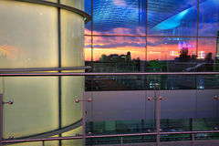 Airport and sunset sky reflected in windows. Airport and sunset sky reflected in glass windows of terminal Stock Image