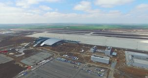 Airport and surrounding area. An aerial view of the airport hangers and surrounding area. High level aerial view of the stock video