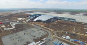 Airport and surrounding area. An aerial view of the airport hangers and surrounding area. High level aerial view of the stock footage
