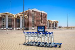 Airport in Taba. Sinai Plateau, Egypt - August 8, 2011: Luggage carts in front of the building of Taba International Airport located in the Sinai Plateau in Royalty Free Stock Image