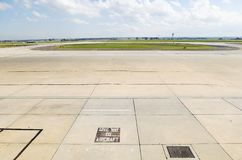 Airport Tarmac. View of Airport Tarmac and aircraft and freight parking bays royalty free stock photography