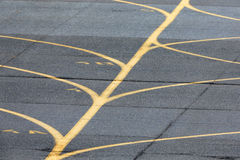 Airport taxiway yellow lines. Near airport runway Stock Image