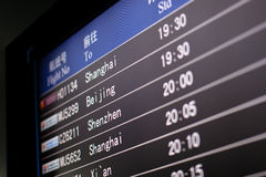 Airport Terminal. The departure board at an airport in China. Flights to Shanghai, Beijing, Shenzhen Royalty Free Stock Images