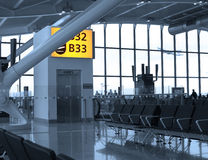 Airport terminal. Departure gate at an airport terminal with flying airplane outside Royalty Free Stock Image