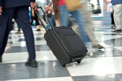 Airport Terminal. Airline travellers and passengers rush through the terminal to their flights with their baggage and luggage Royalty Free Stock Photo
