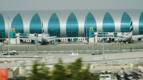 Airport terminal backyard with airliners by bridges in Dubai