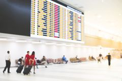 Airport terminal with flight schedule. Airport terminal blur background with flight schedule Stock Photos