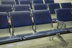 Airport terminal, empty waiting chairs near gate stock image