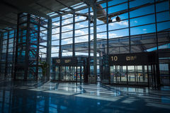 Airport terminal exit and flight Royalty Free Stock Image