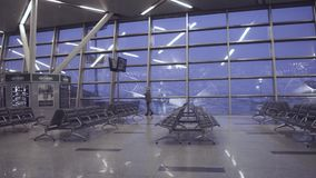 Airport terminal gate dolly shot stock video footage