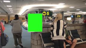 Airport terminal with green ad board Royalty Free Stock Photography
