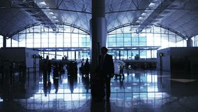Airport terminal hall. Walking travelers silhouettes stock footage