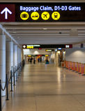Airport terminal hallway and direction sign Royalty Free Stock Photography