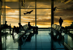 Airport terminal. Passenger wait for transportation with silhouette concept Stock Images
