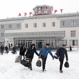 Airport terminal Petropavlovsk-Kamchatsky and station square with people. Kamchatka, Far East, Russia. PETROPAVLOVSK-KAMCHATSKY, KAMCHATKA, RUSSIA - MARCH 19 Stock Image